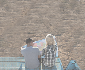 Young couple looking at a map