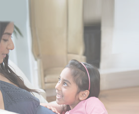 Daughter smiling at her pregnant mom
