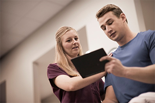 Nurse reviewing document with patient