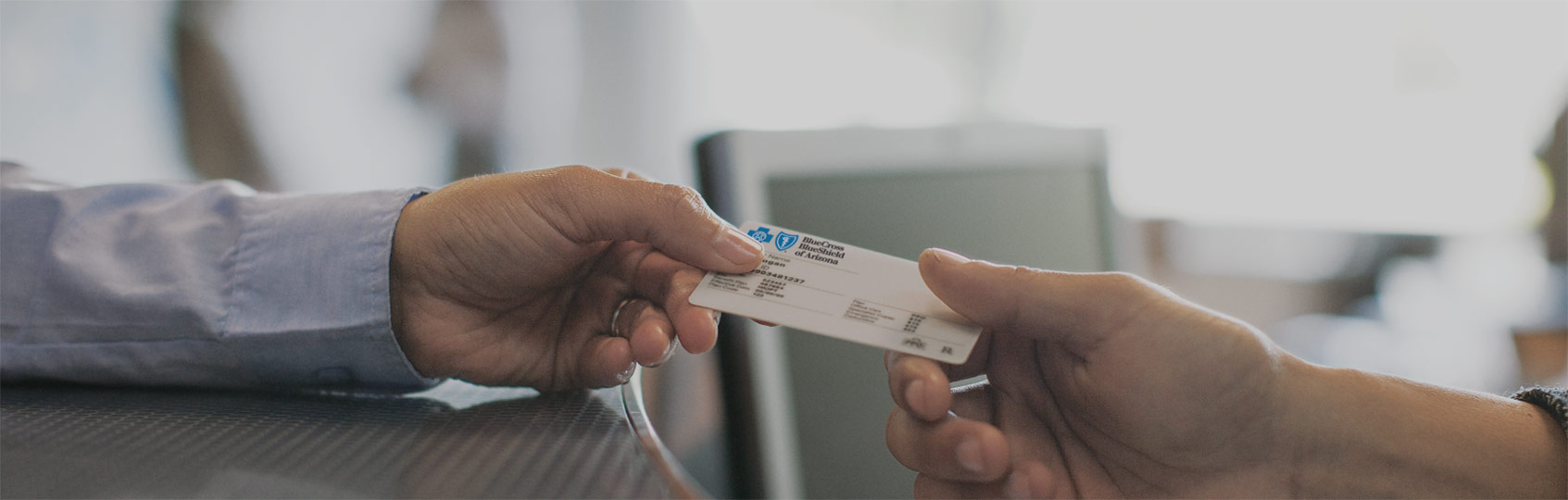 Agent giving a membership card to a member